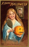 vintage-Halloween-woman-long-hair-mirror-pumpkin-postcard