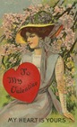 Edwardian vintage valentine card pretty woman brunette with red heart
